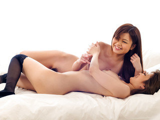 Luscious Nao and a girlfriend share sensual kisses before licking and teasing each others pussies.